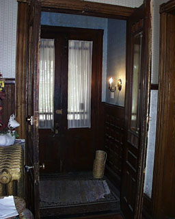 The vestibule. The closed set of doors in the photo open onto the front porch. The open set of doors connect the vestibule to the foyer. & Vestibule and Entryway